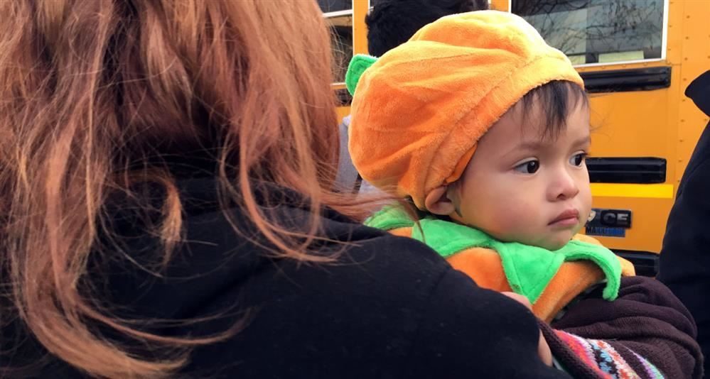 Photo of a young Tioga Trunk-o-Treater in a pumpkin costume